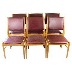 Set of Six Dining Room Chairs of Oak and Upholstered with Bordeaux Leather, of D
