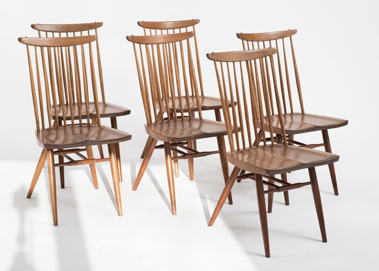Six Nakashima new chairs in walnut and hickory. From the estate of noted architect Joseph St. Cyr of Sanibel Island Florida. Mr. Cyr placed two orders for new chairs with Nakashima, four in 1958 and another four in 1968. The six that remain are