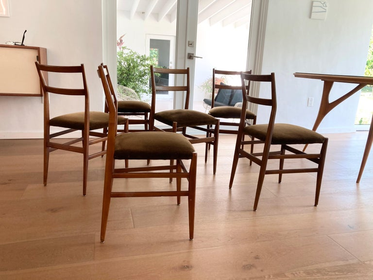 Early set of Gio Ponti dining chairs, the set has age-related wear. Please see all pictures. Table is listed separately.