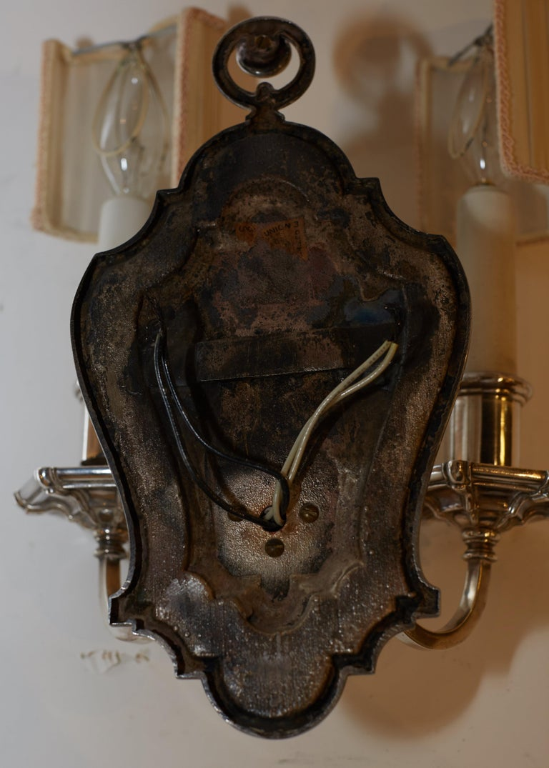 Early 20th Century Set of Six E.F. Caldwell Silvered Bronze Shield Back Sconces For Sale