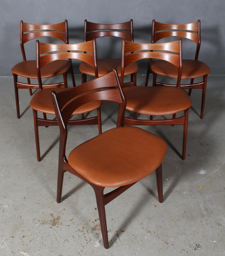 Six Eric Buch chairs with frame of partly solid teak.