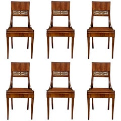Set of Six Fine and Rare Walnut Klismos Style Chairs with Cane Seat