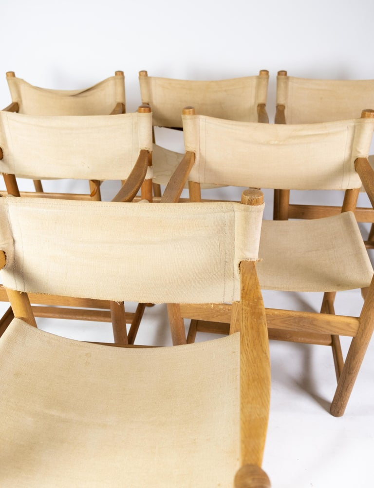 Set of six folding chairs, model J102, designed by Ditte & Adrian Heath for FDB Furniture from the 1970s. The chairs are of oak and light canvas.