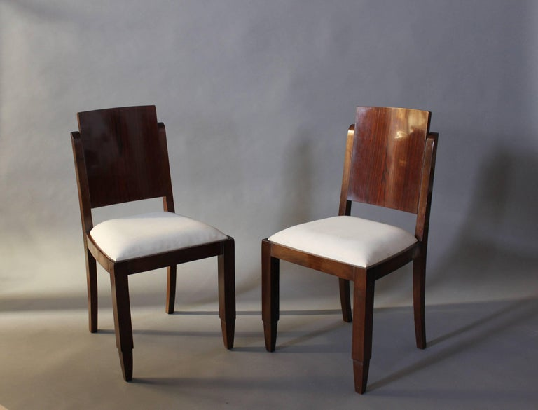 A set of six French Art Deco stained solid beech frames dining chairs with rosewood veneered backs.