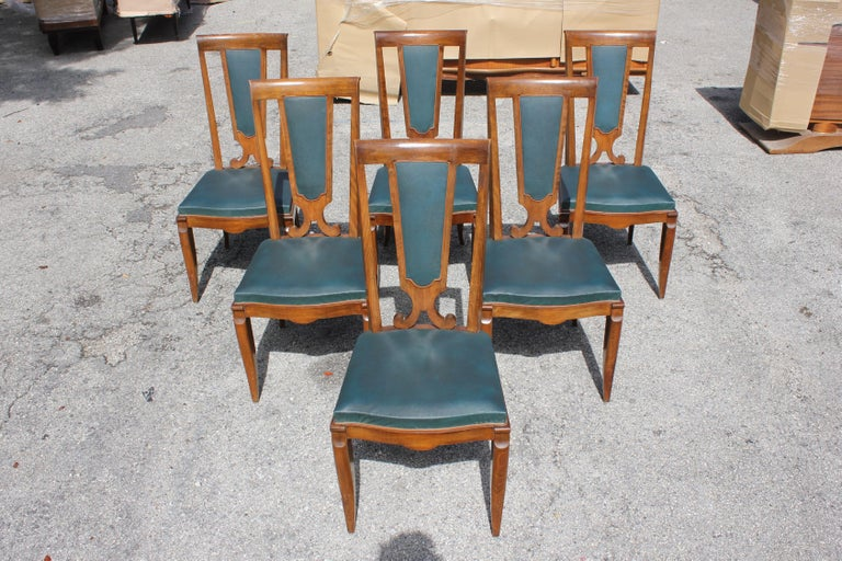 Monumental set of six French Art Deco solid mahogany dining chairs by Jules Leleu, the chair frames are in excellent condition. Reupholstery is vinyl recommended for all six dining chairs, but the color of the dining chairs are beautiful, circa