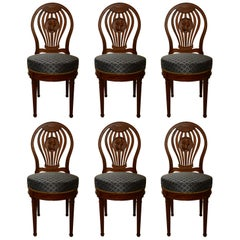 Set of Six French Carved Walnut Chairs