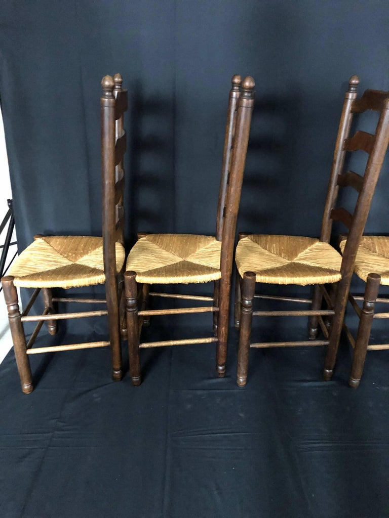 Classic set of 6 French Country ladderback dining chairs with rush seats from Normandy in great condition. #5123.