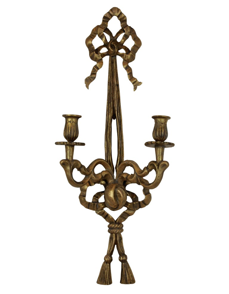 A set of six French carved and gilded wall sconces.