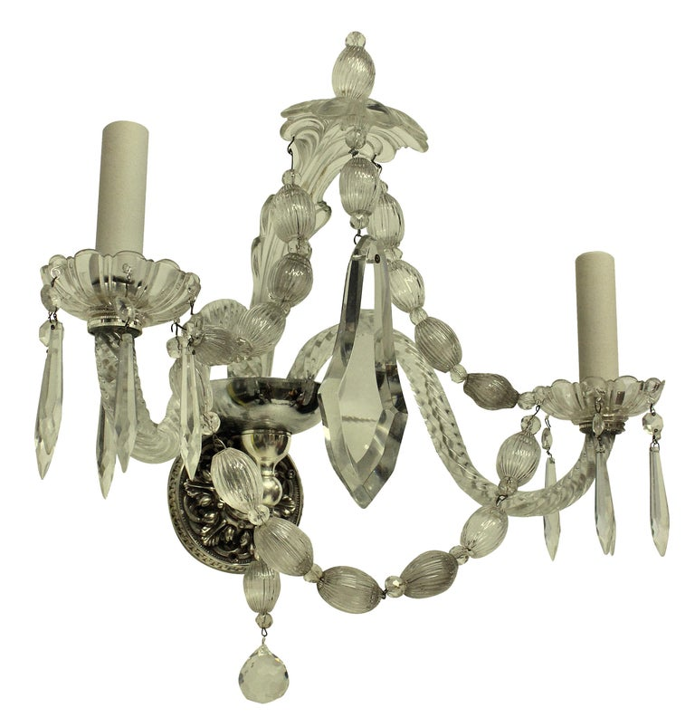 A set of six twin branch French wall sconces in cut and moulded glass.