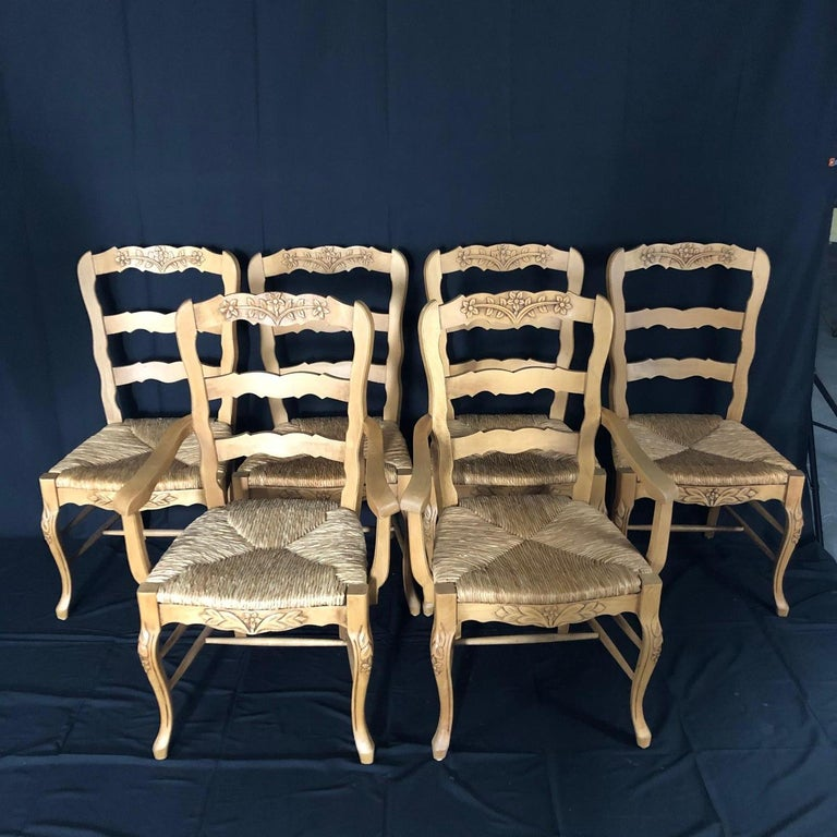 Mid-20th Century Set of Six French Provincial Carved Ladderback Dining Chairs with Rush Seats For Sale