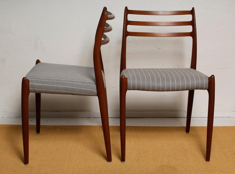 Fully restored set of six Niels O. Møller (model No 78) teak dining chairs for J.L. Møller, circa 1960. Newly upholstered in grey pinstriped Belgian linen. Branded frames.