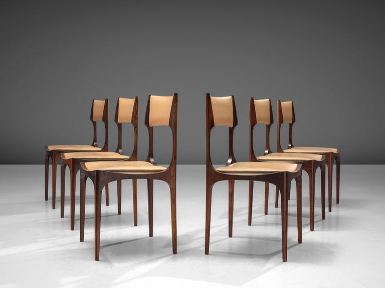 Giuseppe Gibelli for Sormani, set of six dining chairs, maple and leatherette, Italy, 1963.  This elegant set of Italian dining chairs is executed in high-quality maple and beige leatherette. The strength of these chairs lies mainly in the frame.