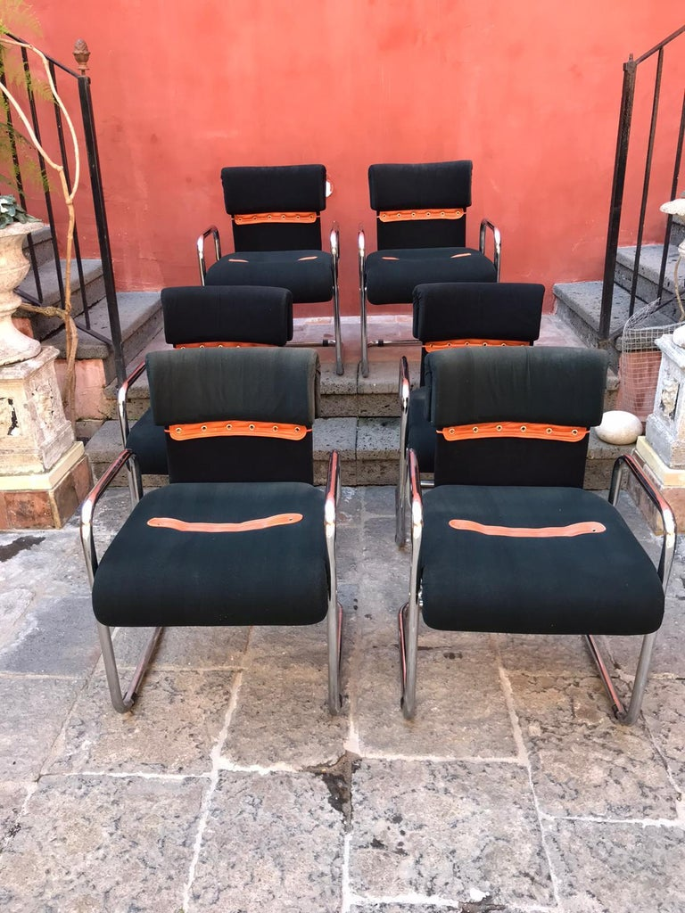 A stylish set of six chairs designed by Guido Faleschini for Mariani are an iconic 1970s vintage seats.