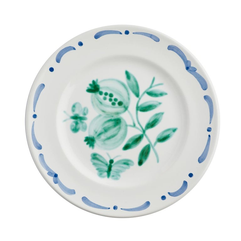 Set of six hands-free painted ceramic dinner plates. Decorated with a handpainted green pomegranate decor in the center and a hands-free painted garlande in blue. The garlande can be ordered in different colors. Produced in Austria in the typical