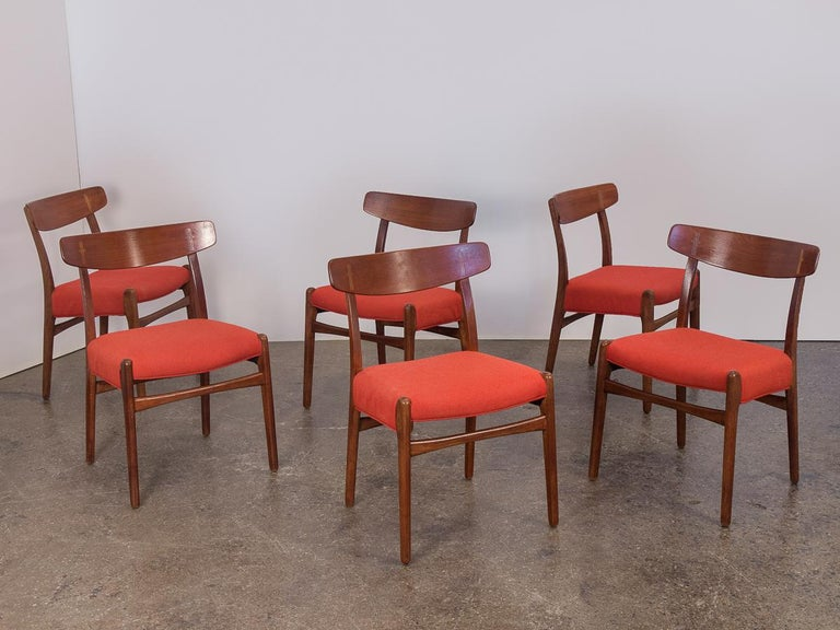 Set of six original Hans J. Wegner Ch-23 dining chairs from the 1950s. Deceptively simple at first glance, the chairs are constructed with elegant details including the fine cruciform cap joinery exposed on the curving backrests. A clean,