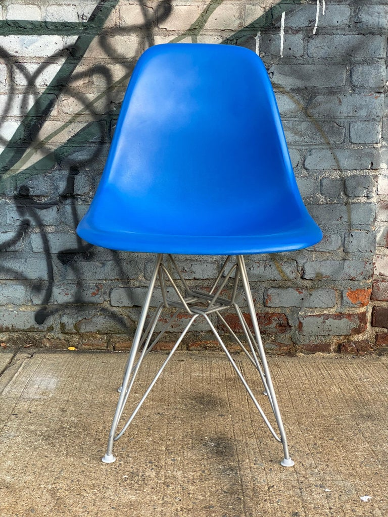 Six vintage Herman Miller Eames fiberglass dining chairs. Chairs in good condition with no cracks. Repainted in beautiful hues and clear coated as well. With modern production Eiffel bases. All glides present and all brand new shock mounts applied