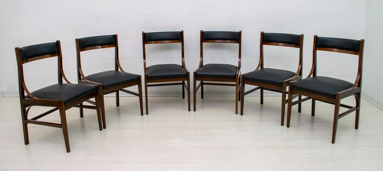 Six chairs mod. 110 by Ico Parisi. Italy, 1961. Produced by Sons of Amedeo Cassina, Meda. Mahogany wood. The chairs have been polished with shellac and have a new leather upholstery.