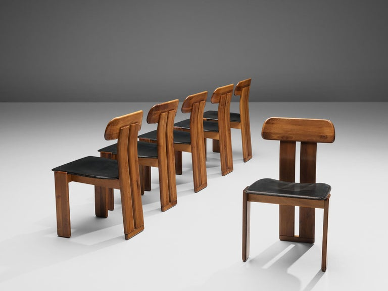 Sapporo for Mobil Girgi, set of six dining chairs, Italian walnut and black leather, Italy, 1970s.  Set of six sculptural chairs that feature wonderful backrests, consisting of two vertical slats distanced from each other. At the bottom and top