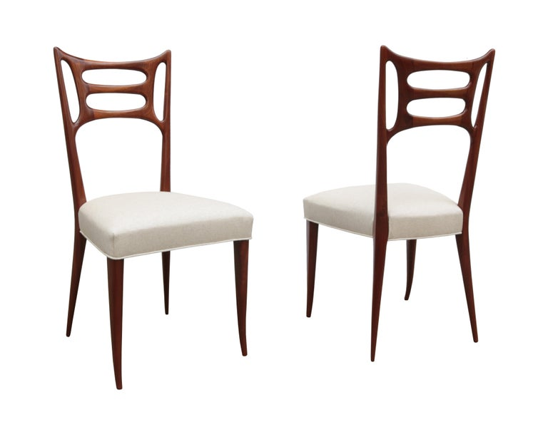 Set of Six Italian Modernist dining chairs Walnut back and legs with upholstered seat.