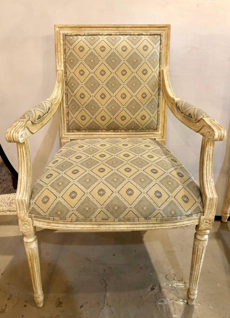 Set of six Maison Jansen Louis XVI style dining chairs in a fine parcel-gilt and paint decorated finish having new upholstery. This wonderful set of custom dining chairs have a Venetian style finish with all over crackle-ware of linen white and a