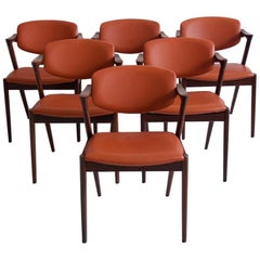 Set of Six Kai Kristiansen Brown Leather and Hardwood Dining Chairs