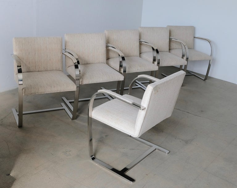 A nice vintage set of six flat bar Brno dining chairs designed by Mies van der Rohe for Knoll. Priced to allow for new upholstery. The heavy steel frames are in good vintage condition with some wear mostly at the bases see last photos. Arm is