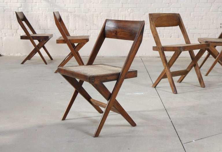 Set of six library chairs with teak headband and caned seat stretched