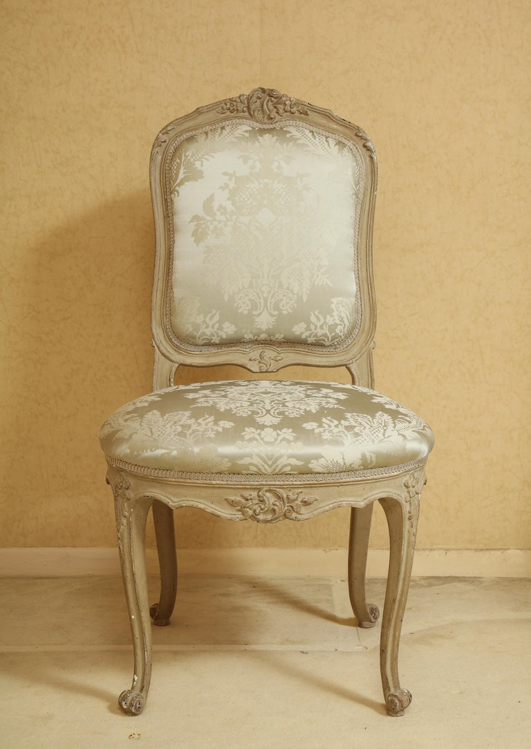 Set of six Louis XV A La Reine style grey acanthus silk grey painted wood fully sprung upholstered dining chairs A most elegant and complete set of six French Louis XV A La Reine style hand painted distressed grey washed wood dining chairs. Each