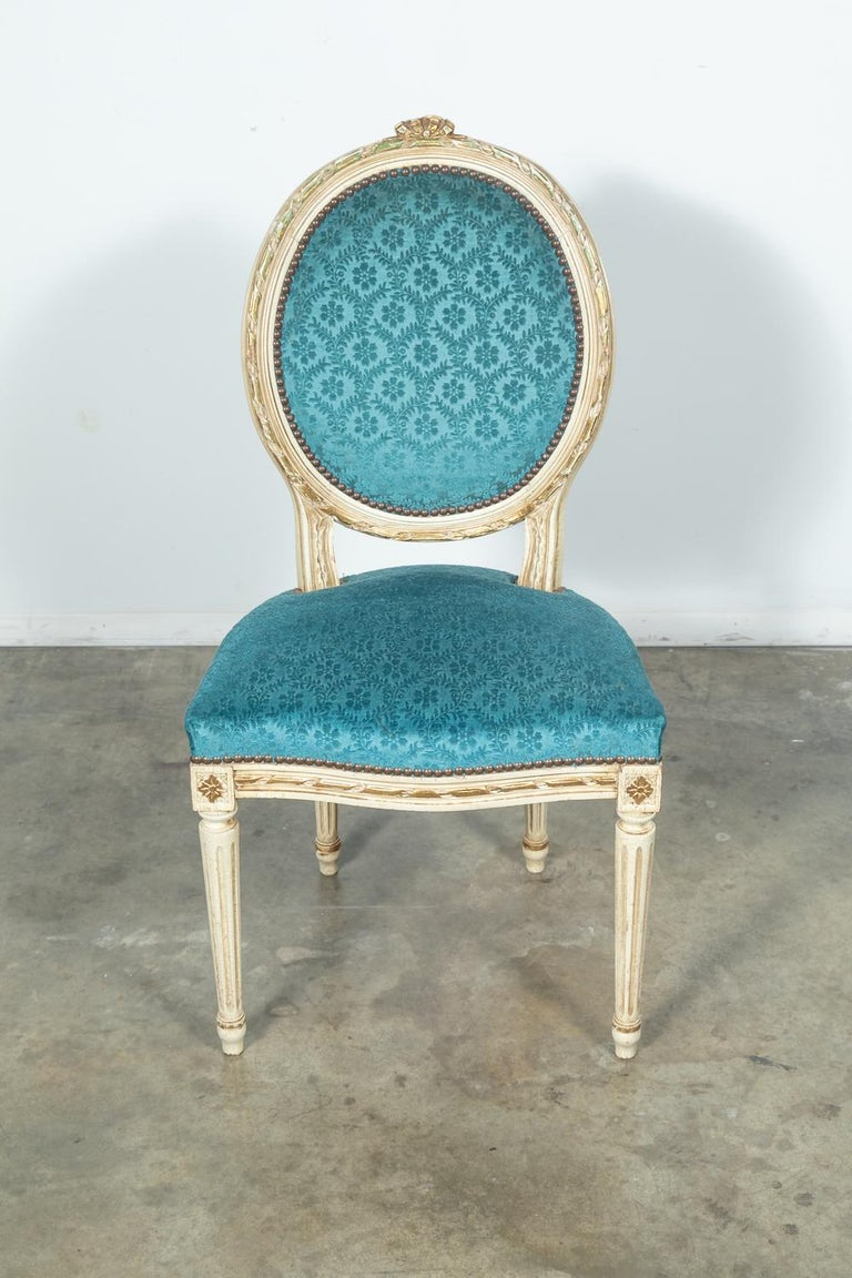 French Set of Six Louis XVI Style Maison Jansen Parcel-Gilt and Painted Dining Chairs For Sale