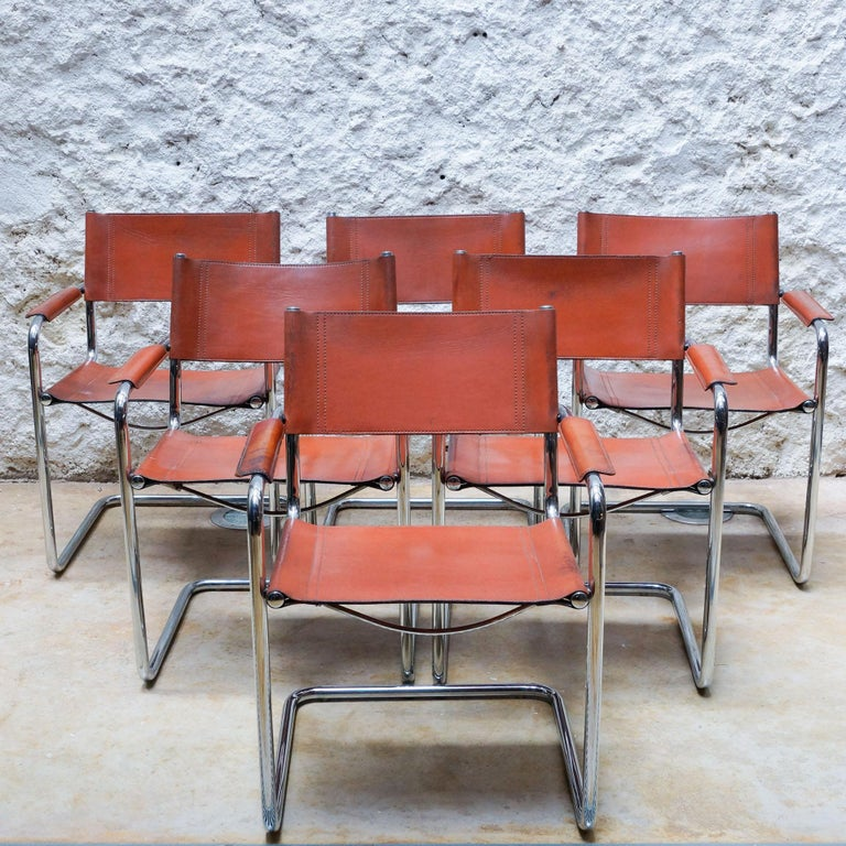 B34 chairs designed by Marcel Breuer, circa 1926. Manufactured by Matteo Grassi, circa 1970.  In original condition, with minor wear consistent with age and use, preserving a beautiful patina.   Materials: Tubular