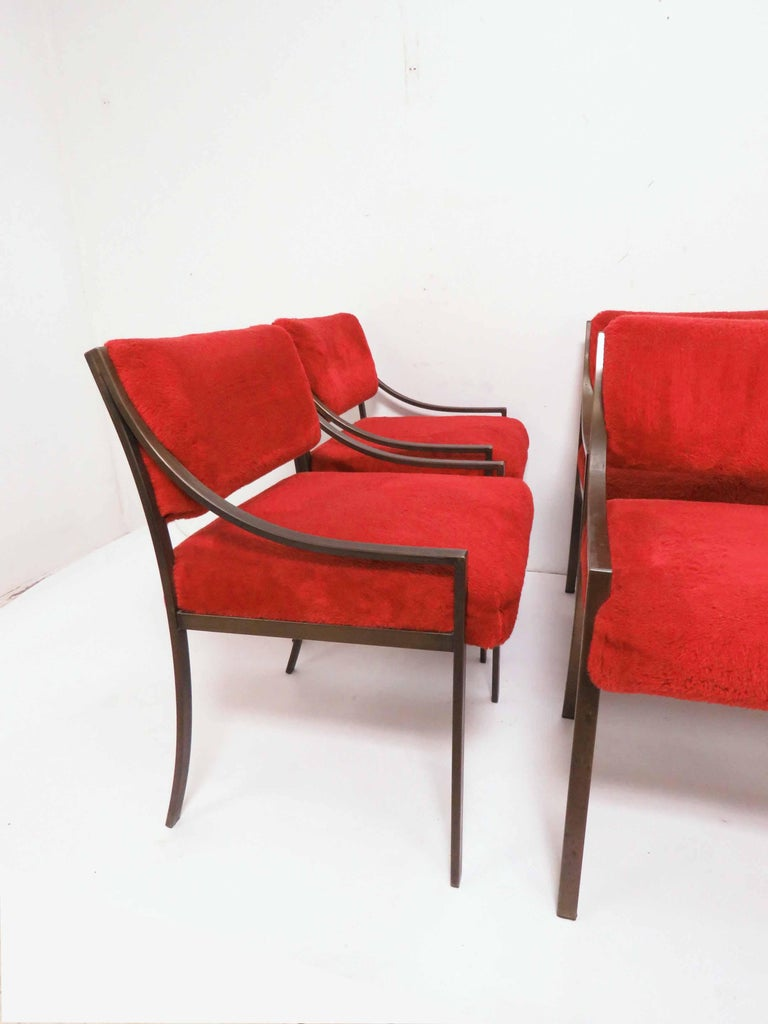 Set of six dining chairs in bronzed steel, in the manner of Mastercraft, circa 1970s. In their original red velour upholstery.