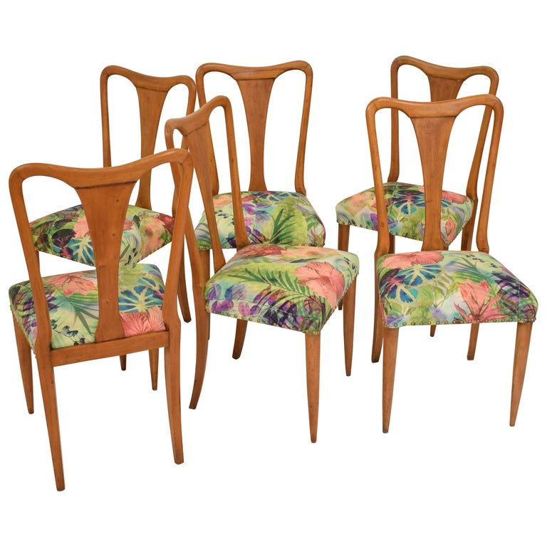 This elegant set of six chairs in hardwood where designed and made in Italy in the early 1940s. The chairs are probably designed by Osvaldo Borsani. They are similar to the chair 4879 which he designed in 1938 for the Casa Cappelli. The chairs are