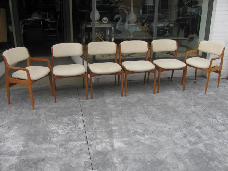 Beautiful set of six sculptural teak Danish dining chairs by Benny Linden. Set consists of two armchairs and four sides. Armchairs are 22.5in wide, sides are 20in wide. Fabric, wool blend and original is in very good used condition with no damage.