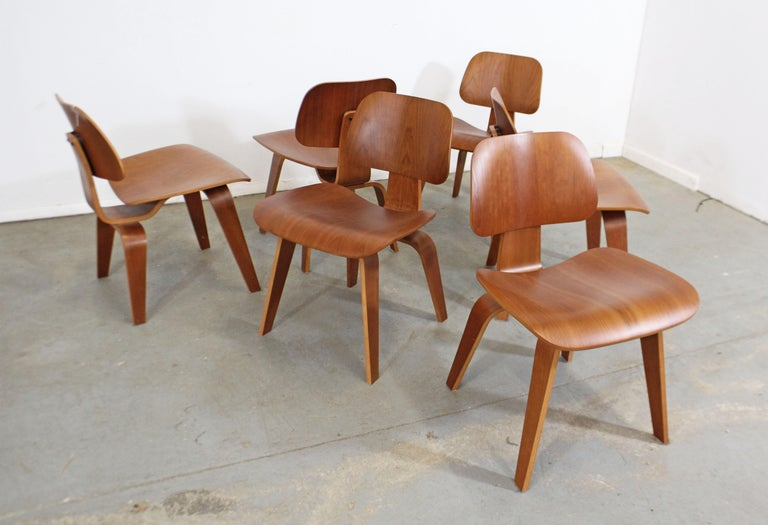 What a find. Offered is a very cool set of six Mid-Century Modern dining chairs, designed by Eames for Herman Miller. These chairs are made of molded plywood in a natural cherry finish. Expertly crafted with a molded seat and back, this chair