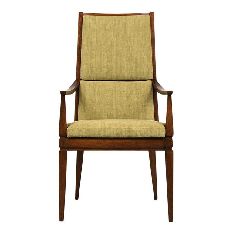 This Set of Six 1960's Mid-Century Modern high back Dining Chairs feature completely restored walnut wood frames. The two armchairs and four side chairs are stained a rich walnut color with a lacquered finish. The seats have been professionally