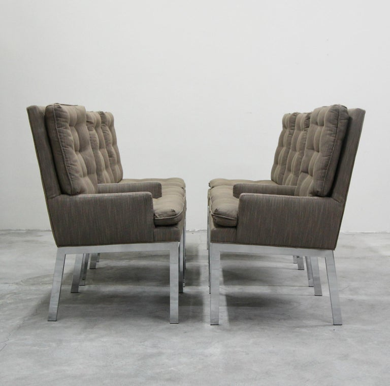 Exquisite set of chrome dining chairs designed by Milo Baughman for Design Institute America (DIA). Mirrored chrome, modern beauties. Nicely angled legs. Recently upholstered, upholstery is in good used condition overall.