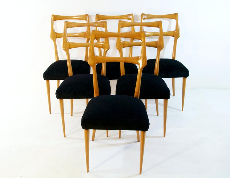 A set of six Italian dining chairs with a sublime organic design in maple attributed to Augusto Romano and re-upholstered in black velvet. The chairs have supreme craftsmanship and are in great condition. Very comfortable for long dinner