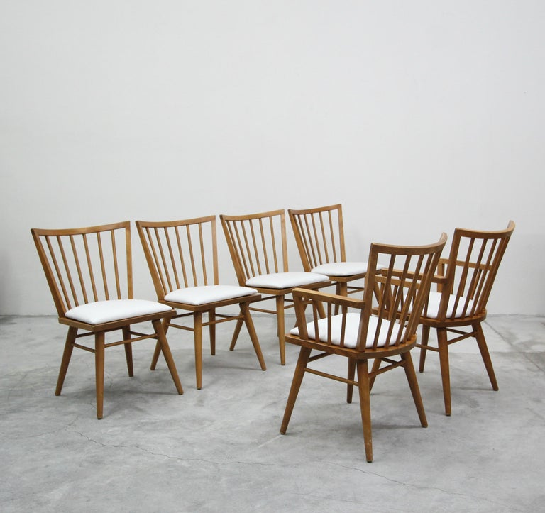 Beautiful set of six midcentury spindle back dining chairs by Conant Ball, designed by Leslie Diamond. These chairs have a very clean, minimalist design and their solid, maple construction, makes them stylish and durable.  Chairs are in excellent