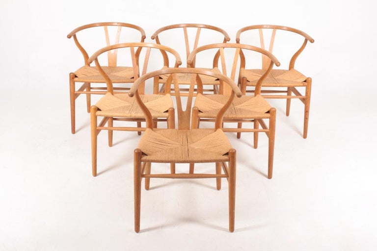 Set of six wishbone chairs in oak and paper cord designed by Hans J Wegner. Great original condition.