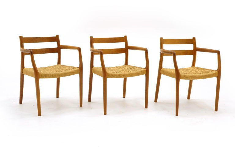 Scandinavian Modern Set of Six Moller Dining Chairs, All Armchairs, Teak and Paper Cord Seats For Sale