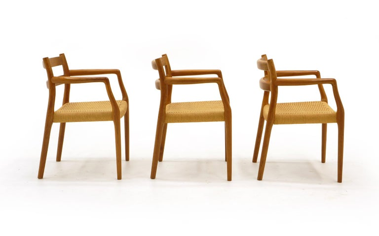 Danish Set of Six Moller Dining Chairs, All Armchairs, Teak and Paper Cord Seats For Sale