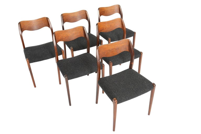 This set of six Møller model 71 dining chairs in Brazilian rosewood are a rare find. Designed in 1951 by Niels Otto Møller for J.L. Møllers Møbelfabrik, this set boasts superior craftsmanship throughout. This quintessential Scandinavian set offers a