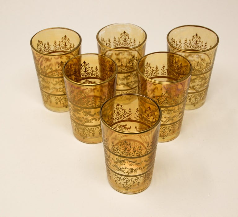 Set of six Moorish glasses with gold and amber design Decorated with a gold pattern frieze. Use these elegant glasses for Moroccan tea, or any hot or cold drink. Perfect for the holidays and gorgeous on display in a cabinet or bar while not in