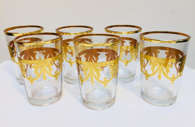 Set of six Moorish glasses with gold raised overlay design Decorated with a classical gold pattern frieze. Use these elegant glasses for Moroccan tea, or any hot or cold drink. In fantastic condition, perfect for the holidays and gorgeous on display