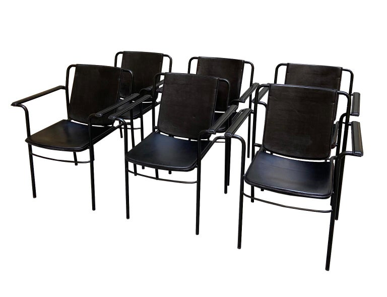 Mario Marenco for Poltrona Frau, set of six 'Movie' armchairs, metal and leather, Italy, 1984.  Set of six of Italian armchairs. The seat are padded and upholstered in black leather. The edges have a black finish. The tubular frame is made of