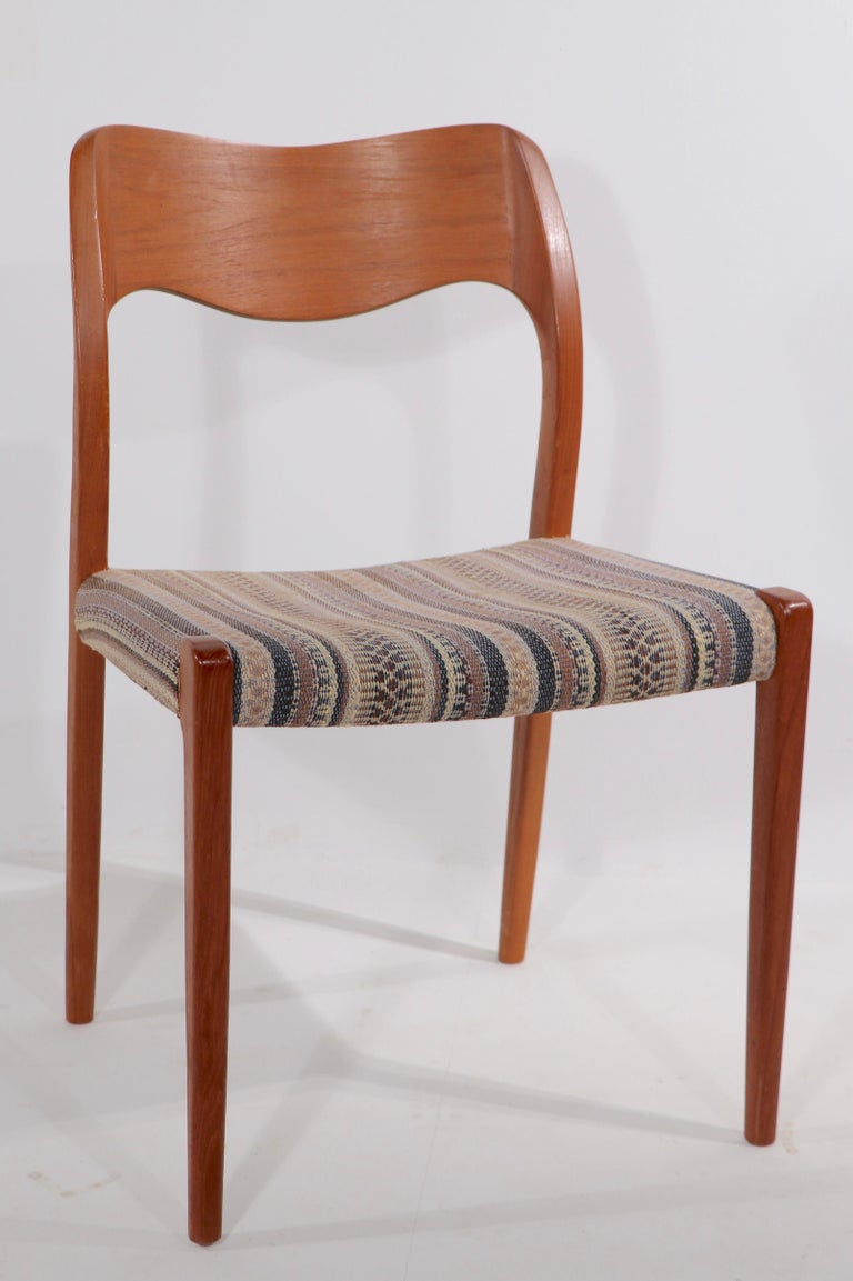 Original clean set of Niels Moller design model 71 dining chairs made by J.L. Mollers. This set is of solid teak, with fabric upholstered seats. All are in very fine, ready to use condition, one seat has inconsequential wear to the fabric - please