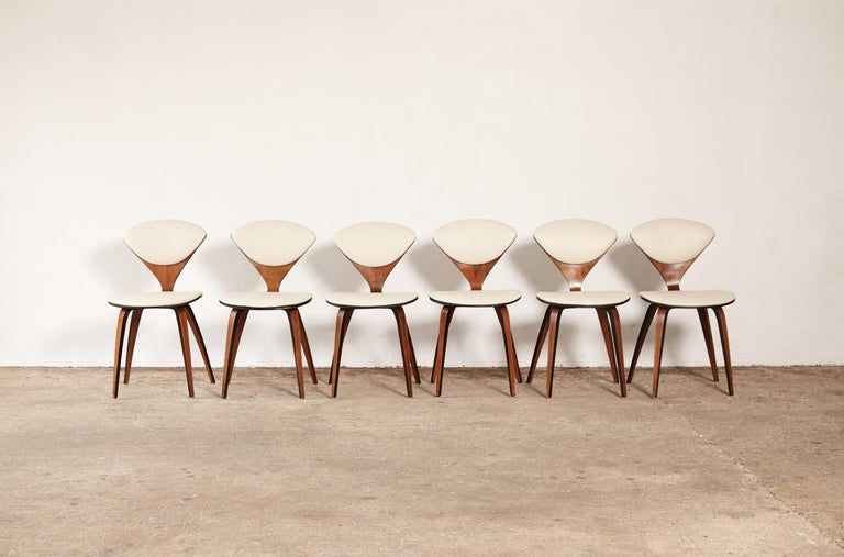 A set of six original Norman Cherner pretzel dining chairs, made by Plycraft, USA in the 1960s. Bentwood frames. Newly upholstered in ivory vinyl.