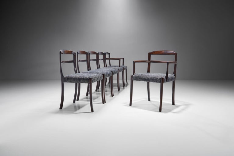 This set of dining chairs by Danish designer Ole Wanscher features distinctive splayed legs and fine exposed joinery in the back. The design is honest and simple with a refined technique and materials which makes this set a true example of