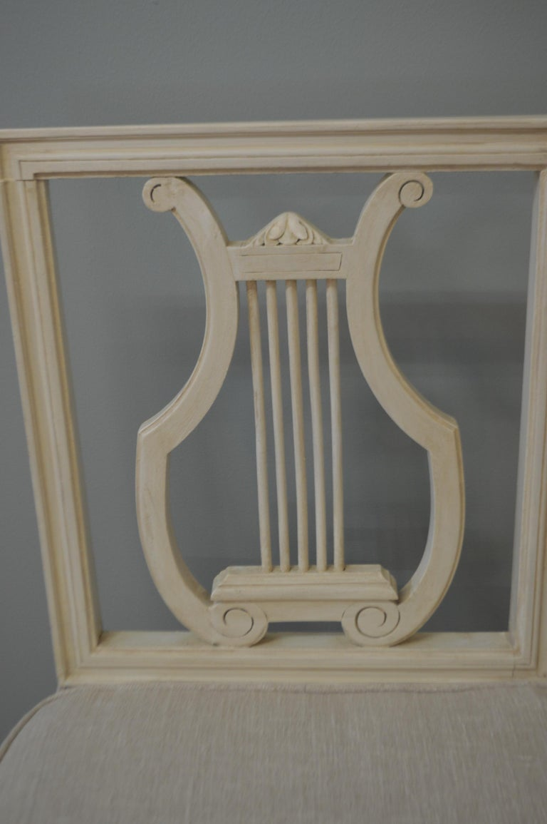 Set of six lyre back dining chair painted in light cream color with caned seat, the cane is in excellent condition. We had six removable linen seat cushions custom-made, they attached to the back with velcro and the fabric can be removed for