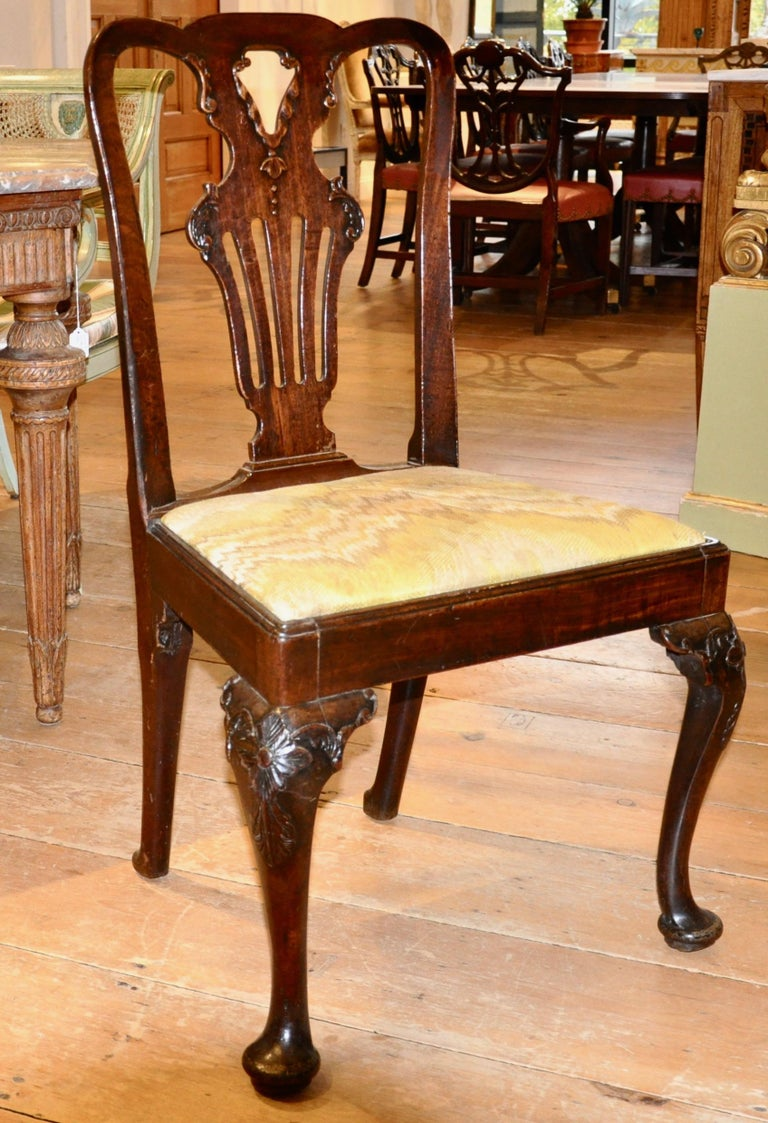 Set of six period English walnut George II side chairs  Six period Georgian side chairs in transitional form moving from Queen Anne to George II in design and age. Original finish. Great patina. Fine condition. Usable and stable and of modern size.